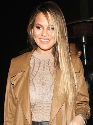 Chrissy Teigen Shows Off Impressive Post-Baby Bod Out to Dinner, Sounds Off On Her Haters!