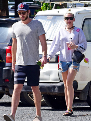 Engagement Back On?! Miley Cyrus and Liam Hemsworth Grab Lunch With His Parents In Australia