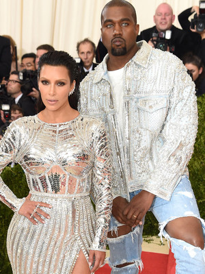 Kim Kardashian and Kanye West Coordinate in Silver Sequins -- Check Out His Creepy…
