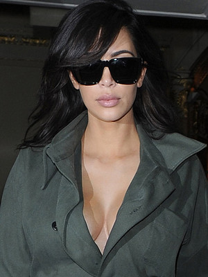 Kim Kardashian Rocks Plunging Flight Suit While Celebrating Her Anniversary with Kanye