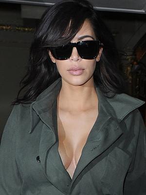 Kim Kardashian Rocks Plunging Flight Suit While Celebrating Her Anniversary with Kanye