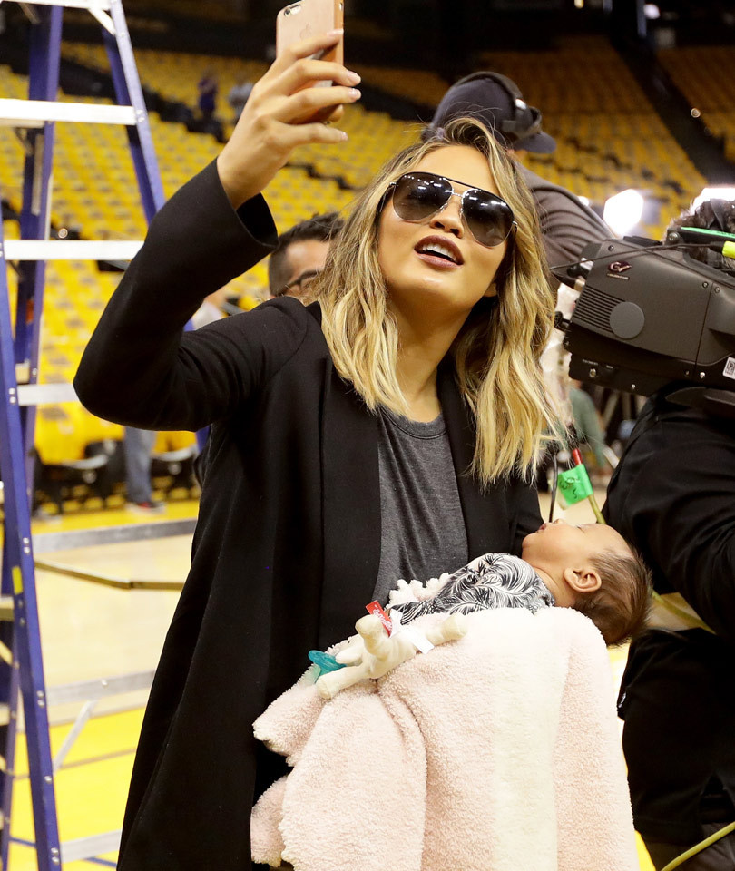 John Legend & Chrissy Teigen Bring Baby Luna To First Basketball Game, Share Breastfeeding Photo!